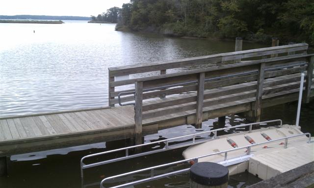 Wooden dock leading to boat ramp